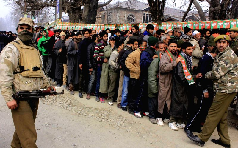 People queue-up to enter the venue of Prime Minister Narendra Modi's rally in Srinagar, on Dec 8, 2014. - Narendra Modi