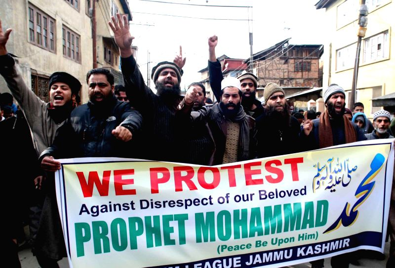 People stage a protest against Charlie Hebdo - French satirical weekly magazine for publishing sketches of Prophet Muhammad in Srinagar, on Jan 23, 2015.
