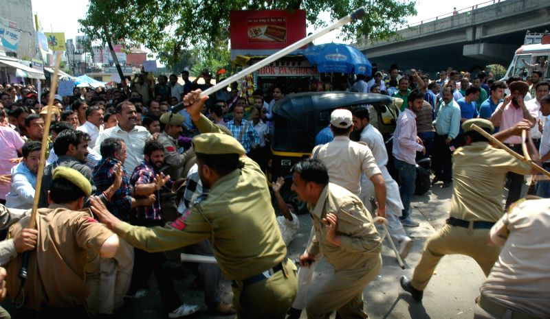 Policemen charge lathis on demonstrating Jammu and Kashmir Rehbar-e-Taleem Teachers in Srinagar, on April 13, 2015.