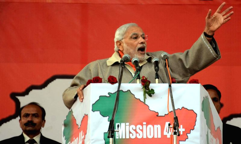 Prime Minister Narendra Modi addresses a rally at Shar-e-Kashmir Cricket Stadium in Srinagar, on Dec 8, 2014. - Narendra Modi
