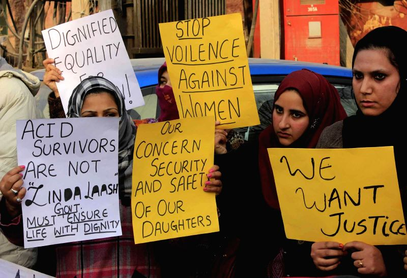 Protesters hold a demonstration to protest against acid attack on a law student and to press for strict action against the attackers in Srinagar, on Dec 12, 2014.