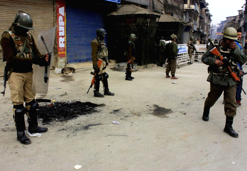 Security forces deployed on the streets of Srinagar as separatists call for a shutdown during the fourth phase of Jammu and Kashmir Assembly elections in Srinagar, on Dec 14, 2014.