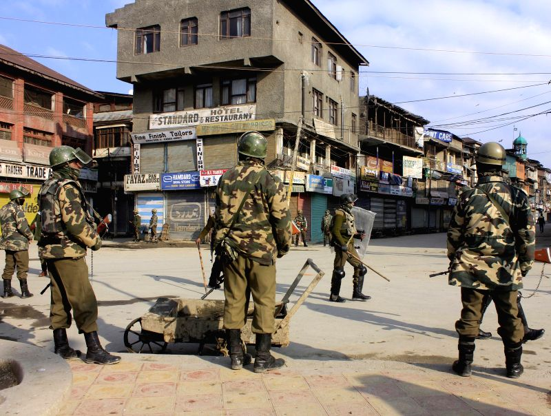 Security personnel deployed on the streets of Srinagar as authorities imposed restrictions in parts of the city to thwart separatist protests on the death anniversary of parliament attack ..