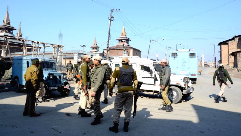 Security personnel in large numbers deployed in Srinagar as restrictions were imposed in the city following the death of a youth in a firing by the security personnel in Palhallan area of ..