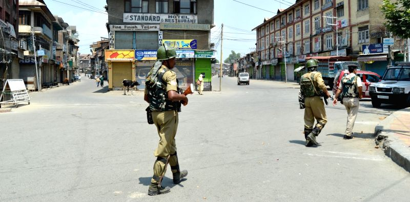 : Srinagar: Security personnel man roads Srinagar during a separatist-called shutdown on Sunday in support of Article 35A that gives special powers to the state legislature on Aug 5, 2018. The ...