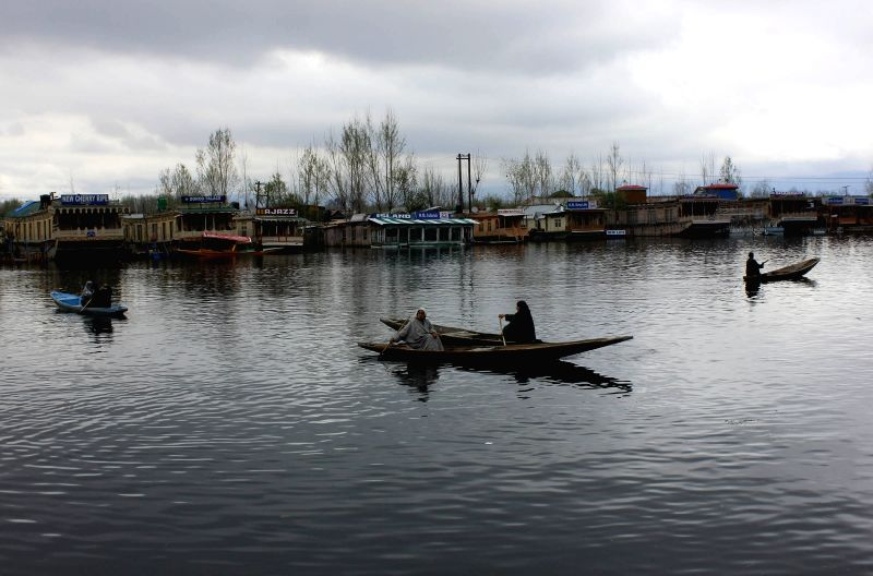 Shikaras sail on the Dal Lake on an overcast day in Srinagar, on April 2, 2015.