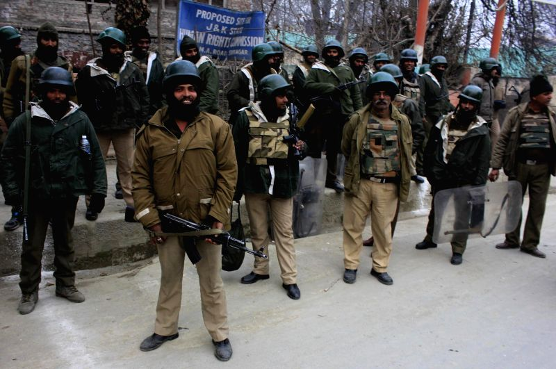 Soldiers at the site of stone-pelting in Srinagar during the fourth phase of Jammu and Kashmir assembly polls on Dec 14, 2014.