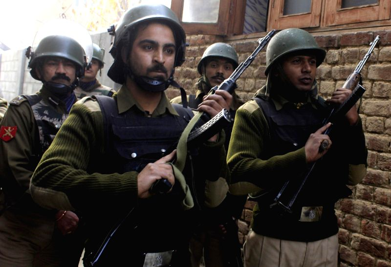 Soldiers during an encounter with separatist guerrillas who attacked the police checkpost in Soura area of Srinagar on Dec 5, 2014.