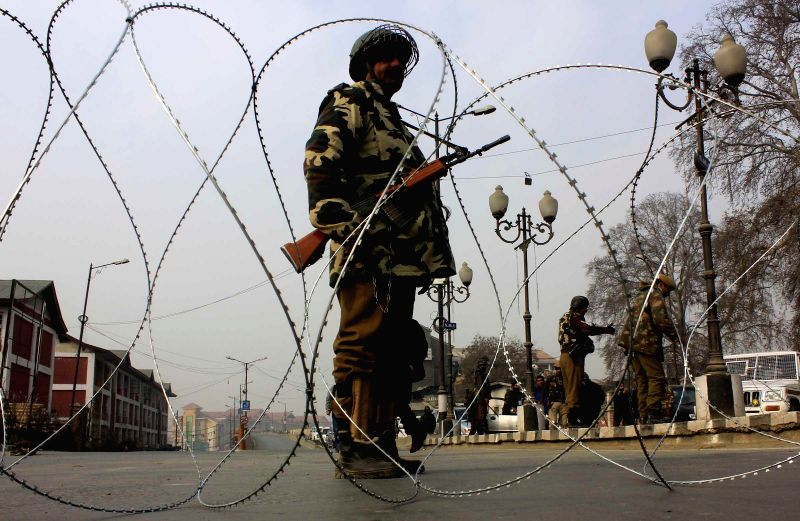 Soldiers man a deserted road of Srinagar as separatists call a strike to protest against Prime Minister Narendra Modi's visit to the valley on Dec 8, 2014. - Narendra Modi