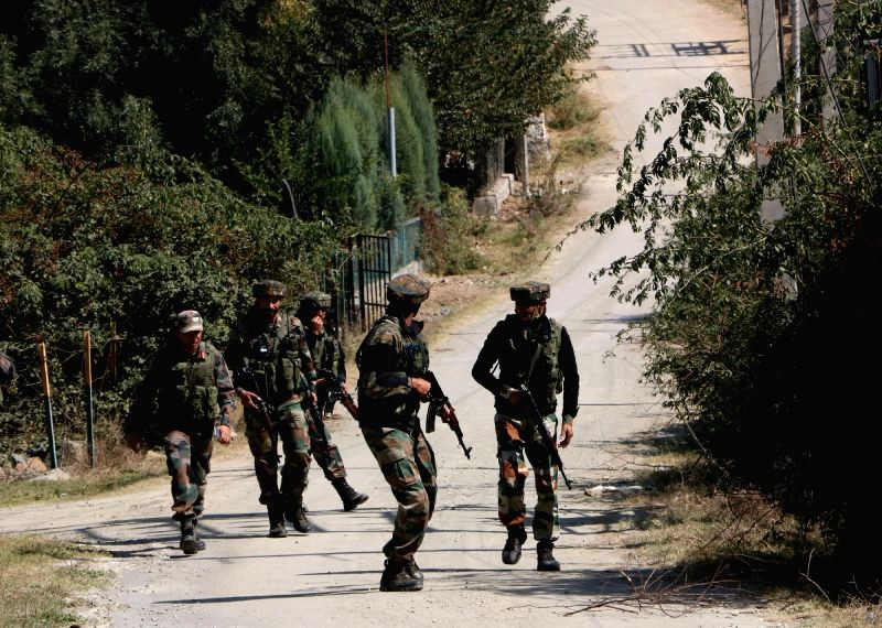 Srinagar: Soldiers rush to take their positions after suicide attackers of Pakistan-based Jaish-e-Mohammed terror outfit carrying guns and explosives stormed a BSF camp near the highly secured Srinagar international airport on Oct 3, 2017. Three mili