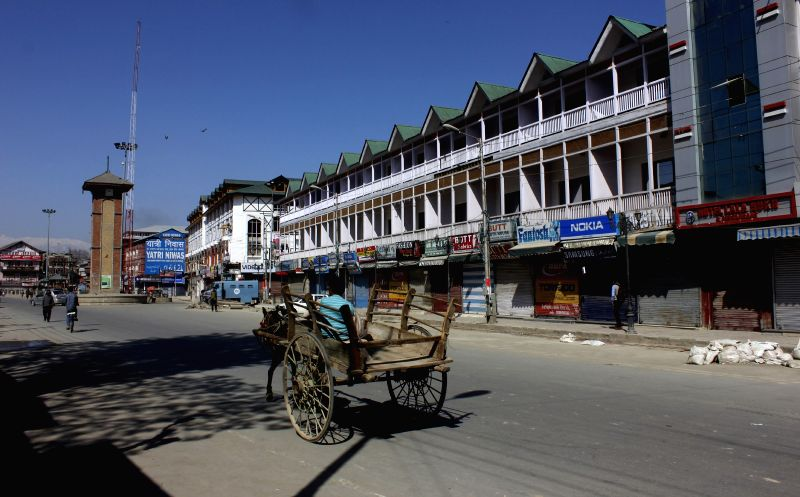 Srinagar wears a deserted look during a Hurriyat Conference strike called to press for the release of separatist leader Masrat Alam on April 25, 2015.