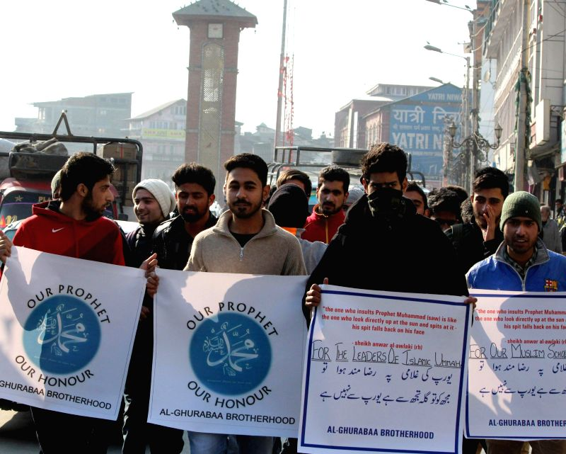 Students stage a demonstration against Charlie Hebdo - French satirical weekly magazine for publishing sketches of Prophet Muhammad in Srinagar, on Jan 16, 2015.