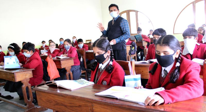 Students wear masks in classroom as a protective measure against seine flu in Srinagar on Feb 27, 2015.