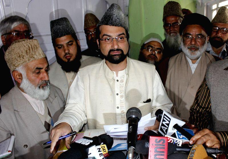 The chairman of moderate faction of Hurriyat Conference, Mirwaiz Umar Farooq addresses a press conference in Srinagar, on April 15, 2015.