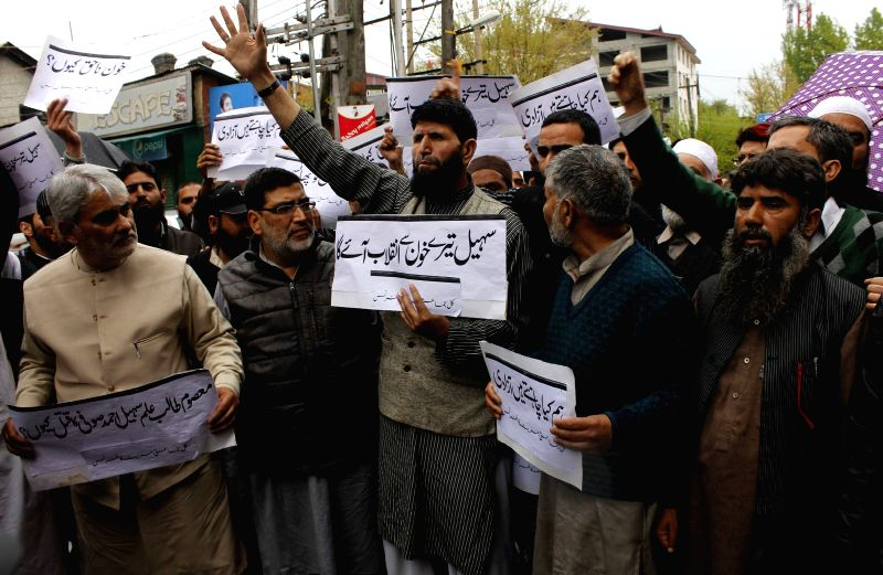 The members of Hurriyat Conference, Muslim League and other orgnisations stage a demonstration at press enclave against Narbal and Tral killings in Jammu and Kashmir, in Srinagar on April ...