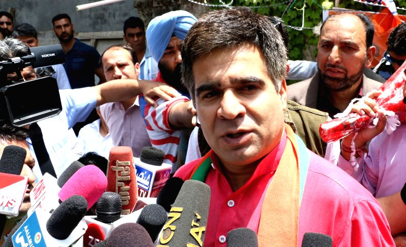 : Srinagar: The newly elected BJP Jammu and Kashmir President Ravinder Raina, talks to the press, in Srinagar on May 16, 2018. (Photo: IANS).