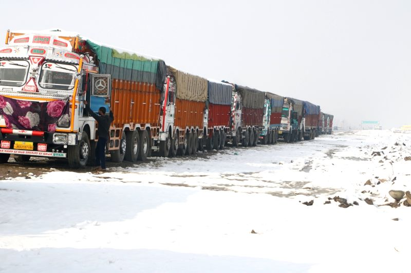 Srinagar: Trucks left stranded on Srinagar-Jammu highway after heavy snowfall led to the closure of the highway, on Jan 5, 2019.