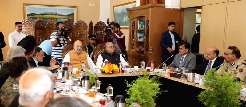 Srinagar: Union Home Minister Amit Shah chairs a meeting to review the security arrangements for the Amaranth Yatra, in Srinagar on June 26, 2019. Also seen  Jammu and Kashmir Governor Satya Pal Malik, Union Home Secretary Rajiv Gauba and other senio