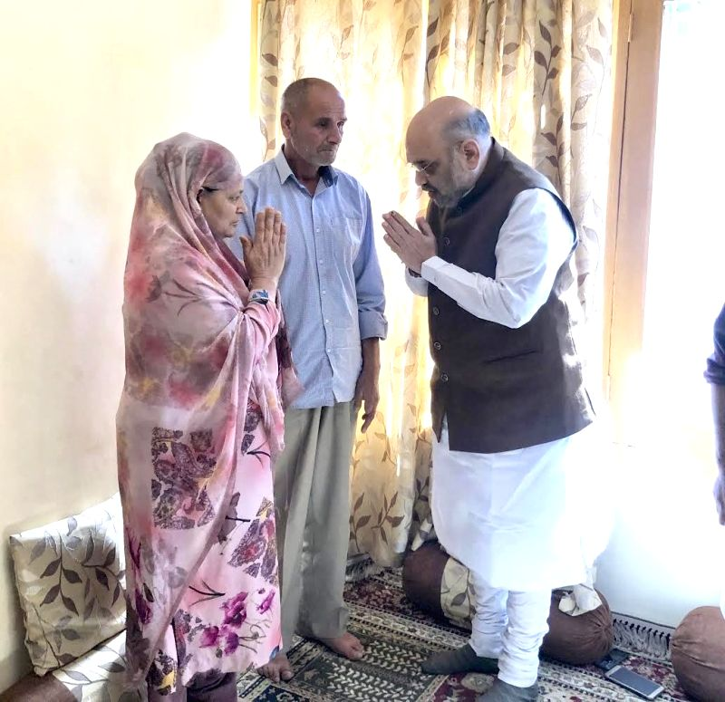 Srinagar: Union Home Minister Amit Shah visits the family members of Station House Officer (SHO) Arshad Khan, who succumbed to his injuries, sustained in a 'Fidayeen' attack by a Pakistani militant in K.P. Road area of Anantnag town; in Srinagar, on