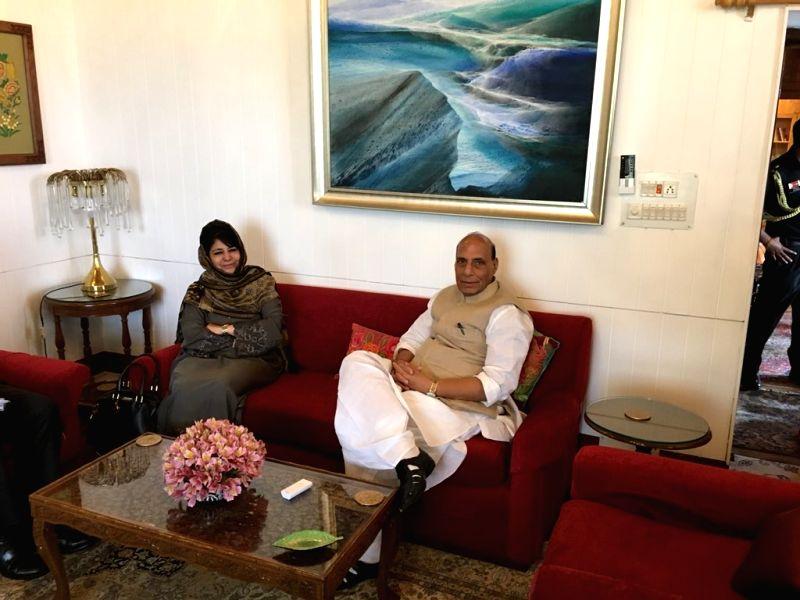 Srinagar : Union home minister Rajnath Singh meets Jammu and Kashmir Chief Minister Mehbooba Mufti in Srinagar on June 7, 2018. - Rajnath Singh and Mehbooba Mufti