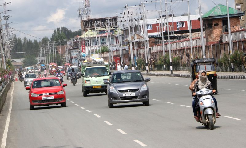 Srinagar: Vehicles ply on a Srinagar road on Aug 16, 2019. Jammu and Kashmir Chief Secretary B.V.R. Subrahmanyam announced on Friday restrictions in Jammu and Kashmir placed after the axing of Article 370 will be lifted in a phased manner from Friday