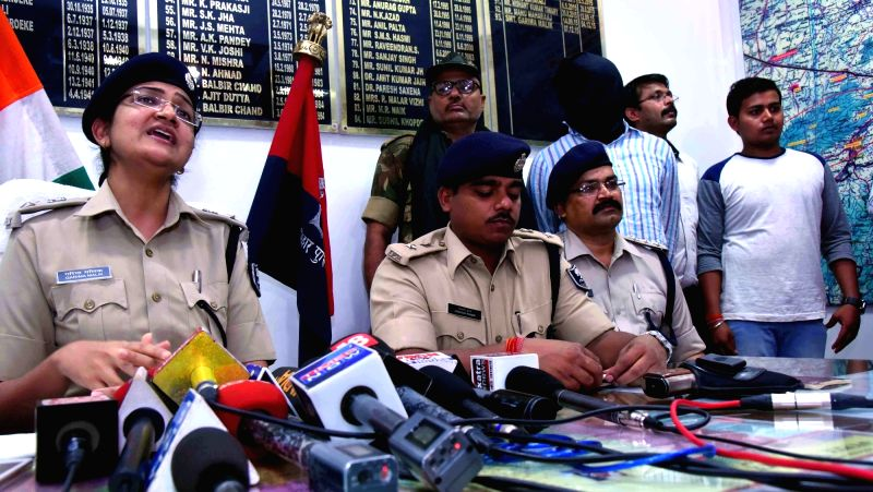 SSP Gaya Garima Malik addresses a press conference after arresting Rocky Yadav, the son of a JD(U) legislator who allegedly shot dead Aditya Sachdeva, the teenaged son of a businessman, on 7th ... - Malik and Yadav