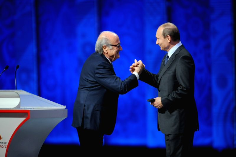 ST.FIFA's president Sepp Blatter (L) shakes hands with Russia's President Vladimir Putin during the preliminary draw for the 2018 FIFA World Cup at Konstantin ...