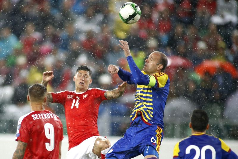 ST.Ildefonso Lima (2nd R) of Andorra vies with Steven Zuber (2nd L) of Switzerland during the FIFA World Cup 2018 Qualifiers Group B match between Switzerland and ...