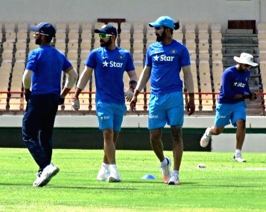 St Lucia: Indian Test captain Virat Kohli (C) during a practice session at Darren Sammy Stadium in St Lucia on Aug 7, 2016. - Virat Kohli