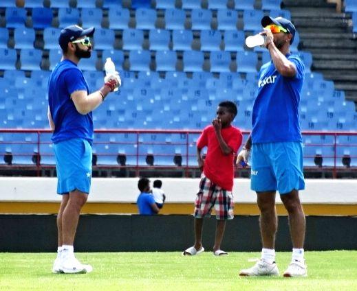 St Lucia: Indian Test captain Virat Kohli (L) during a practice session at Darren Sammy Stadium in St Lucia on Aug 7, 2016. - Virat Kohli