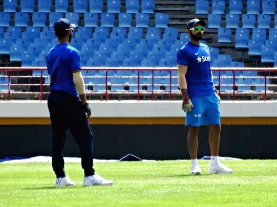 St Lucia: Indian Test captain Virat Kohli (R) during a practice session at Darren Sammy Stadium in St Lucia on Aug 7, 2016. - Virat Kohli
