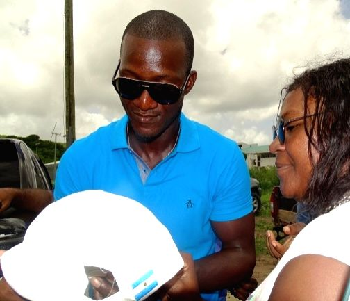 St Lucia: West Indies player Darren Sammy with his supporters outside the Darren Sammy Stadium in St Lucia on Aug 9, 2016.