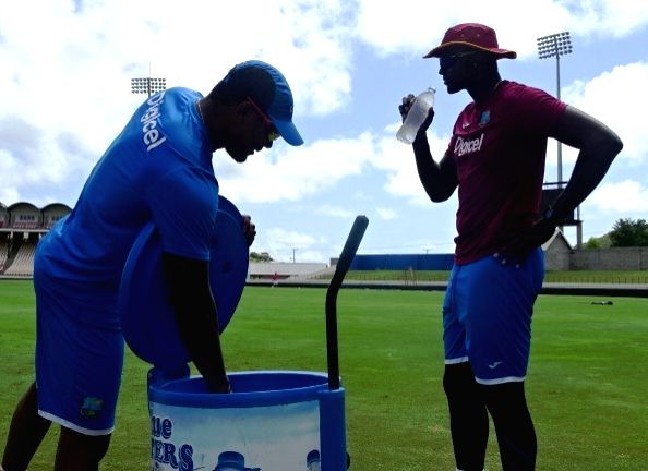 St Lucia: West Indies' skipper Jason Holder (R) during a practice session at Darren Sammy Stadium in St Lucia on Aug 7, 2016.