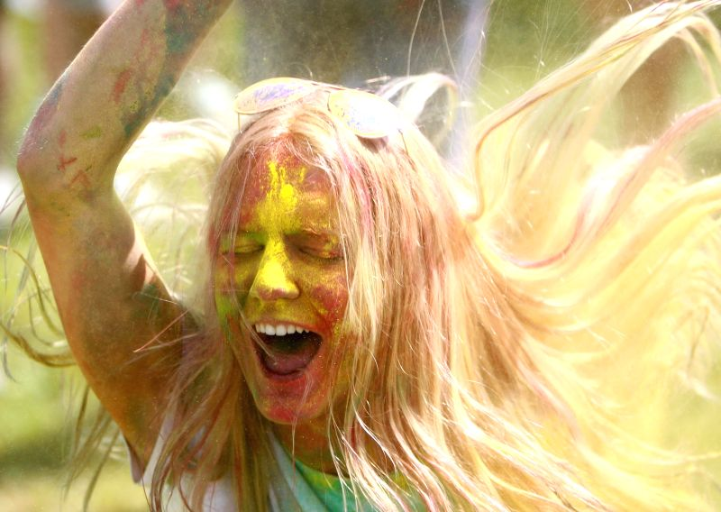 ST.A girl participates in the Festival of Colors in St. Petersburg, Russia, on July 19, 2014.