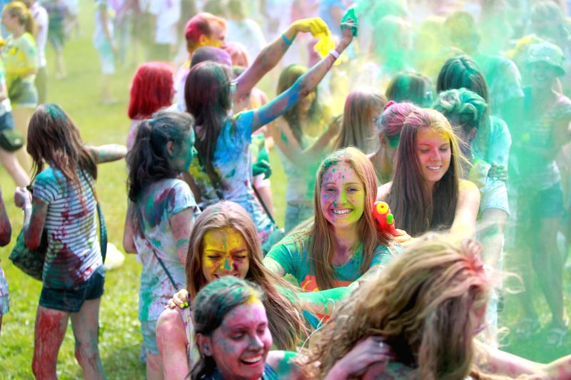 ST.People participate in the Festival of Colors in St. Petersburg, Russia, on July 19, 2014.