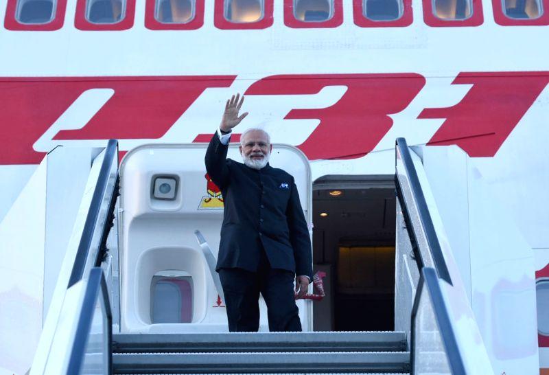 St. Petersburg: Prime Minister Narendra Modi emplanes for Paris after an eventful visit, in Russia on June 2, 2017. - Narendra Modi