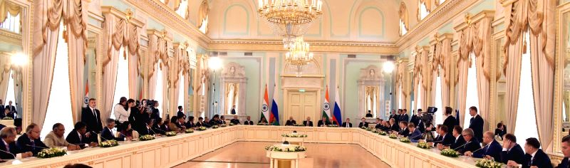 St. Petersburg: Prime Minister Narendra Modi and Russian President Vladimir Putin, at India-Russia CEO's meeting, at Konstantin Palace, in St. Petersburg, Russia on June 1, 2017. - Narendra Modi