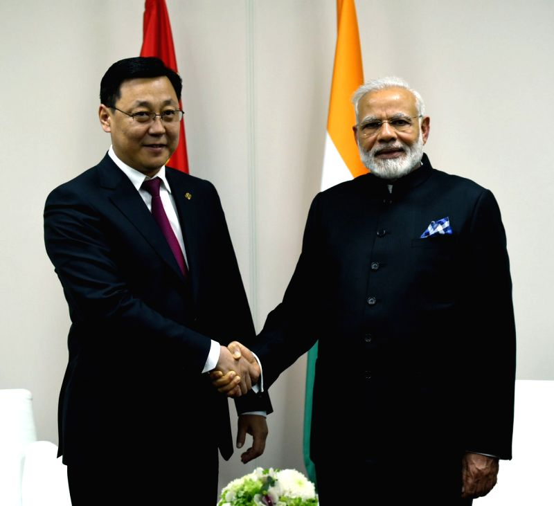 St. Petersburg: Prime Minister Narendra Modi meets Mongolian Prime Minister J. Erdenebat, on the sidelines of the SPIEF2017, in St. Petersburg, Russia on June 2, 2017. - Narendra Modi