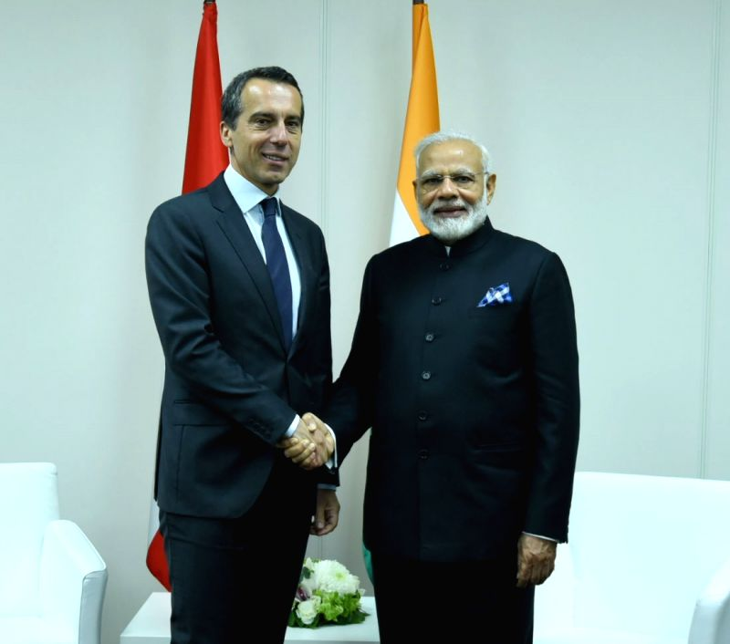St. Petersburg: Prime Minister Narendra Modi meets Austrian Chancellor Christian Kern, on the sidelines of the SPIEF2017, in St. Petersburg, Russia on June 2, 2017. - Narendra Modi
