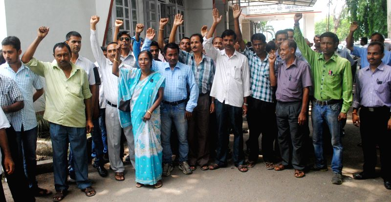 Staff of Kamrup (Metro) Deputy Commissioner's office demonstrate against rough behavior of an ADC in Guwahati on July 10, 2014.