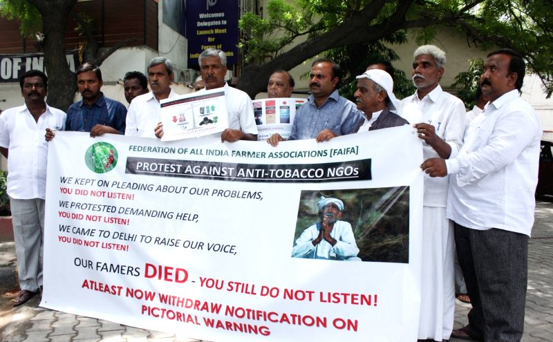 Stakeholders of tobaco industry stage a demonstration against government's anti-tobaco initiative on World No Tobacco Day in New Delhi, on May 31, 2016.