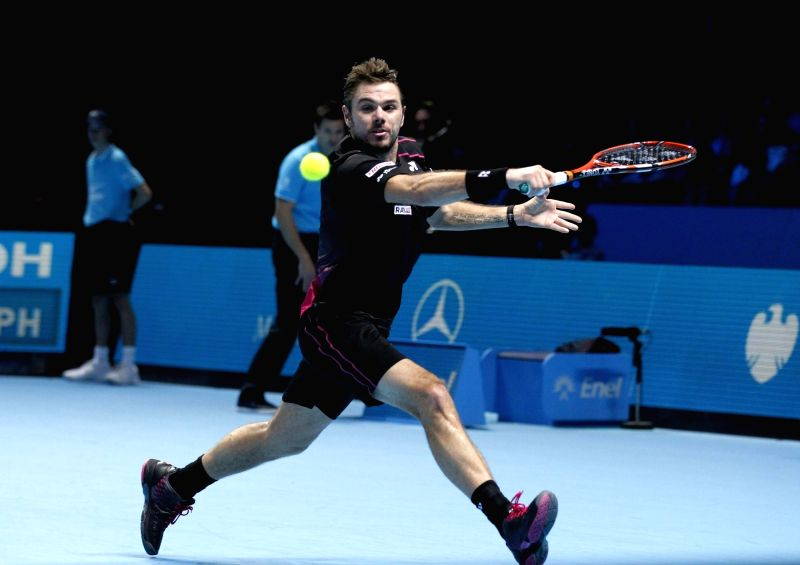 Stan Wawrinka of Switzerland hits a return during the group stage match against Andy Murray of Britain at the ATP World Tour Finals in London, Britain, Nov. 20, ...