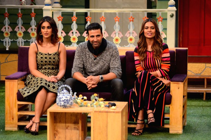 Stand-up comedian Kapil Sharma with actors Ileana D'Cruz and Esha Gupta during the promotion of film Rustom on the sets of The Kapil Sharma Show in Mumbai, India on August 5, 2016 - Ileana D'Cruz, Kapil Sharma and Esha Gupta