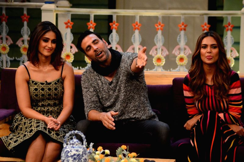 Stand-up comedian Kapil Sharma with actors Ileana D'Cruz and Esha Gupta during the promotion of film Rustom on the sets of The Kapil Sharma Show in Mumbai, India on August 5, 2016. - Ileana D'Cruz, Kapil Sharma and Esha Gupta