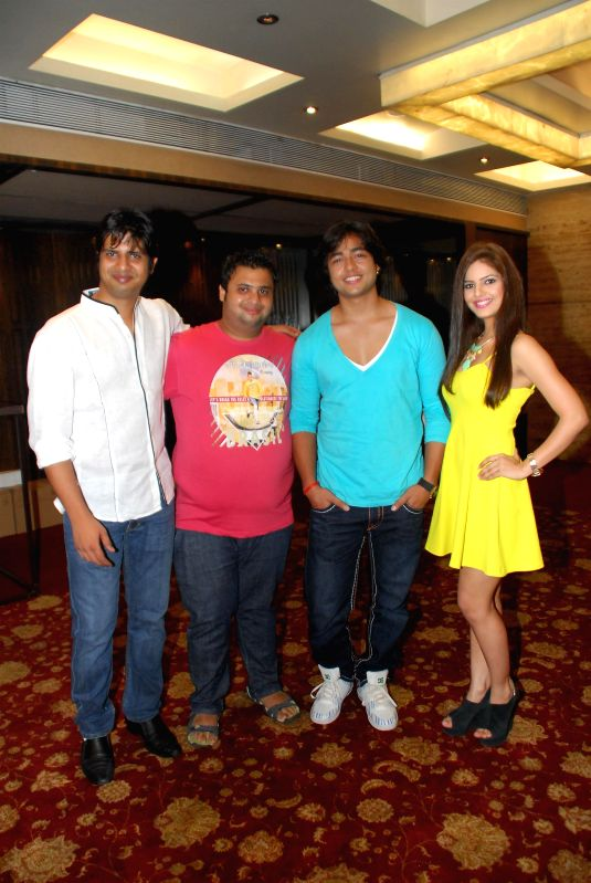 Star cast during the music launch of their upcoming film Trip to Bhangarh, in Mumbai on July 28, 2014. Film Trip To Bhangarh written and directed by Jeetendra, the film, stars fresh faces in lead ...