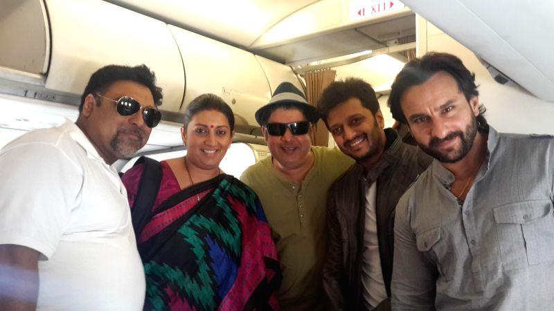 Star-cast of Humshakals - Saif Ali Khan, Riteish Deshmukh, Ram Kapoor & Director Sajid Khan with Minister of Human Resource Development Smriti Irani in a flight on June 16, 2014. - Saif Ali Khan, Riteish Deshmukh, Kapoor and Sajid Khan