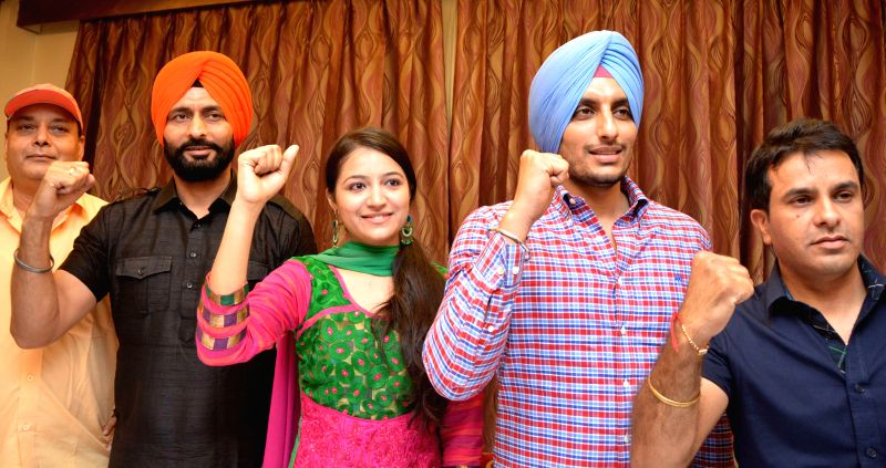 "Star cast of ""Kaum De Heere"" Raj Kakra, Isha Sharma and Sukhdeep Sukha during promotions of their upcoming film in Amritsar on Aug 12, 2014. - Isha Sharma"