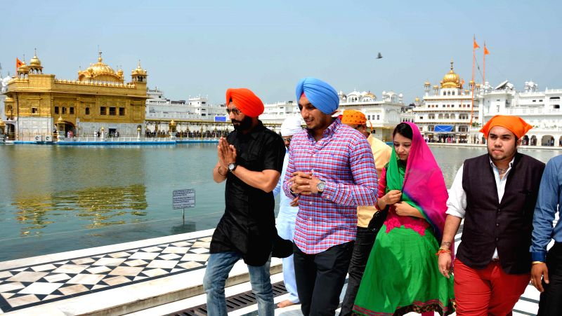"Star cast of ""Kaum De Heere"" Raj Kakra, Isha Sharma and Sukhdeep Sukha pay obeisance at the Golden Temple in Amritsar on Aug 12, 2014. - Isha Sharma"