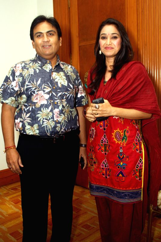 Star cast of  TV serial `Tarak Mehta Ka Oolta chasma`, Dilip Joshi and Disha Vakani at a press meet in New Delhi on June 2014. - Dilip Joshi