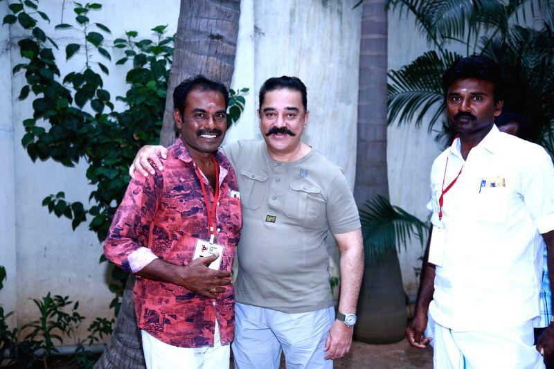 Sterlite protestor Sivakumar meets Makkal Needhi Maiam chief Kamal Haasan in Chennai on July 24, 2018.